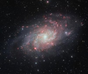 The VLT Survey Telescope at ESO's Paranal Observatory in Chile has captured this beautifully detailed image of the galaxy Messier 33, often called the Triangulum Galaxy. This nearby spiral, the second closest large galaxy to our own galaxy, the Milky Way, is packed with bright star clusters, and clouds of gas and dust. This picture is amongst the most detailed wide-field views of this object ever taken and shows the many glowing red gas clouds in the spiral arms with particular clarity. Credit: ESO